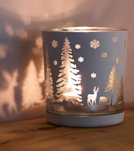 Candles and fragrances with woodland tealight holder pictured