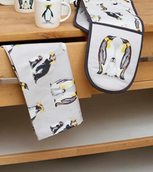 Kitchen textiles featuring Penguin themed oven glove and tea towel