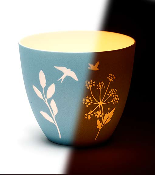 Candles and tealight holders with bird silhouette tealight holder pictured