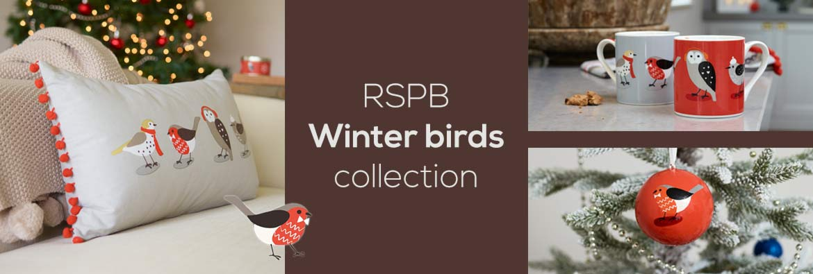 Shop the RSPB Shop Winter birds collection of homewares including stylish mugs, Christmas bauble and cushion. Colours are red and grey and products feature cute bird illustrations in winter clothing or colours.