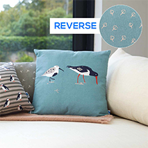 Coastal birds cushion - oystercatcher and dunlin blue product photo